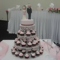 Bride And Groom Figurine With Cupcakes sugar bride and groom top cake with 60 cupcakes with butterflies dragonflys and embossed hearts. A pink and brown theme