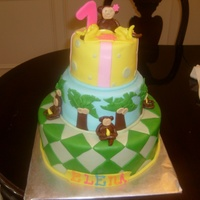 Elena's Monkey Cake Three tier cake covered in MMF with gumpaste monkies. Client got design from Pink Cake Box.