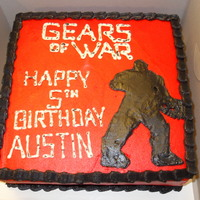 Gears Of War Gears of War themed cake with silhouette of Marcus Phenix. TFL!