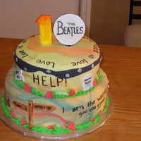 The Beatles A Beatles cake for my daughter's 10th birthday. She helped me decide which songs to reference, we managed to get 15 songs and 2 albums...