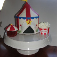 Carnival 6 inch carnival tent was the cupcake stand topper. Popcorn and mini-tent cuppies. Thanks for looking!