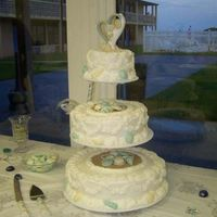Seashell Wedding Cake I love doing beach wedding cakes. This cake was cream cheese flavorwith butter cream icing. The bride and groom loved it.