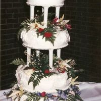 My First Wedding Cake Ever!  This was the very first wedding cake I ever made! It's difficult to see the detail, but it is a 3 flavored cake (white, lemon and...