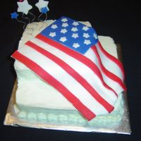 Birthday Cake For A Former Colonel  This is a photo of a cake my daughter and I did for a gentleman that was turning 90! This was a poppy seed cake, with buttercream icing,...