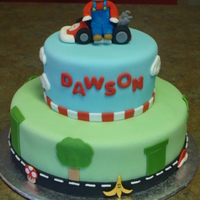 Mario Kart Cake Mario and his gokart are made with fondant. Enjoy!
