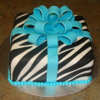 Zebra Present Cake Fondant cake with zebra stripes and fondant bow.