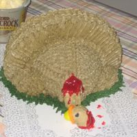 Turkey Cake The head fell off and I tried to attach it several times and it just kept falling so as a quick fix I just piped on some piping gel colored...