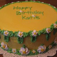 Img_1362.jpg buttercream icing and leaves, royal icing flowers.