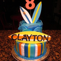Surfboard Birthday Boy! I did this cake for a boy who was having a swim birthday party. His mom had shown me a surfboard cake with several boards but Clayton'...