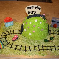Over The Hill 40Th Birthday Cake For my brothers 40th birthday. It includes things that reflect him and his interests all edible except train and candles (bottles)!