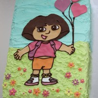 Dora The Explorer Dora cake made for a friend for a 3yr old. Cake covered in buttercream and Dora made from fondant cut out