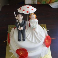 Beach Themed Wedding Cake Wedding cake for beach theme. Groom loves fishing so holding a fishing rod while bride rests back !!