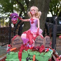 Barbie's Revenge I saw the origional of this on cake central and almost died! It's a doll with a cake skirt in a grave yard. So of course I wanted to...