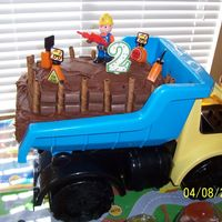 Tonka Truck Cake It's a two layer triple chocolate mint cake w/ ganache filling and choc./mint buttercream frosting. The cake is sitting in the bed of...