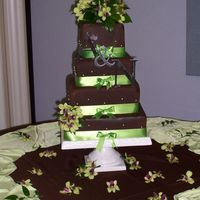 100_1900.jpg My first time covering square cakes in fondant. It's way better than trying to get good corners with buttercream, that's for sure...