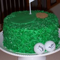 Dad's Birthday German Chocolate cake with tinted coconut. Fondant green, brown sugar bunker, and gag gift golf balls. This was fun to do!