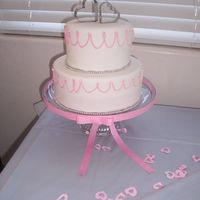 100_1765.jpg My first cake completely covered in fondant. My friend wanted the cake to mimic the invitation. that's why the uneven scallops....