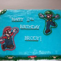 Mario Bro's Cake 1/2 sheet cake done for a 5th birthday. This was fun. I liked using a lot of colors. BC base with FBCTransfer characters. The mushrooms...
