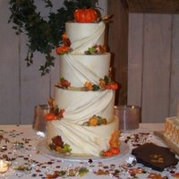 Fall Wedding Cake Fall wedding cake. All edible (except the silk rope border). All pumpkins and leaves were handmade and handpainted.
