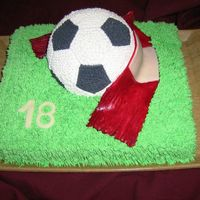 Soccer Ball butter cream cake with gumpaste scarf and numberit's my first ball