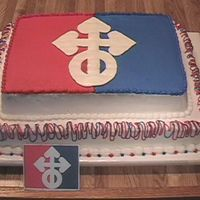 Pana0570.jpg Company logo cake for a business reunion. All in buttercream except BCT for white part of the logo.
