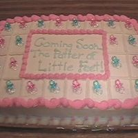 Baby Shower Very simple baby shower cake. The colors were pink and baby blue (the colors didn't photogragh well). Cake sparkles were added for a...