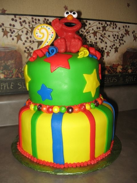 Elmo Cake This was my very first cake! I decided to take on one of the most difficult chores in cake decorating...FONDANT!! I learned alot while...