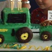"John Deere Tractor My son LOVES john deere's so we had a John deere party. Donuts for wheels, loaf pans and toatsted coconut for the ""hay"""