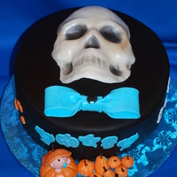Halloween Baby Shower Chocolate cake with center layer of cheesecake. Baby shower for baby due on 11/1. They specifically asked for black fondant and a skull on...