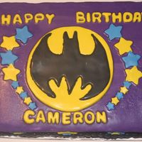 Batman This is a cake I made for my nephew's 5th birthday party. The decorations are all done in fondant and the cake is butter cream...