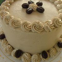 Almond Cake with espresso buttercream and fondant coffee beans