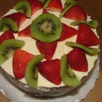 Almond Cake with cream cheese mousse topped with fresh fruit