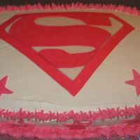 Supergirl_Birthday_Cake.jpg Supergirl. Strawberry cake with vanilla bc icing. Badge is made out of fondant.