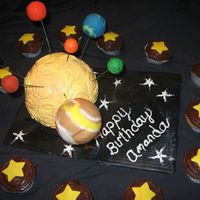 Solar System Used the spots ball pan for the sun. Planets are styraphome balls covered in fondant.