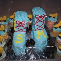 Schuyler's Roller Skates Client wanted Roller Skates w/ cup cakes, this is my 2nd carved cake and not to horrible I think?! The skates are choco,(this did not help...