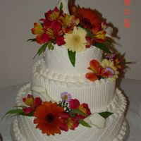 Impression Mats And Fresh Flowers 3 tier wedding cake iced in buttercream, decorated with impression mats and fresh flowers