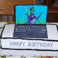 Laptop Cake  the computer is made out of fondont the screen is a FBCT (world of warcraft picture) I piped all of the letters on the keyboard the cake is...