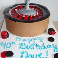 "Roulette Wheel This is a 10"" cake with mmf on the top of it. The gambling chips are mmf as well."