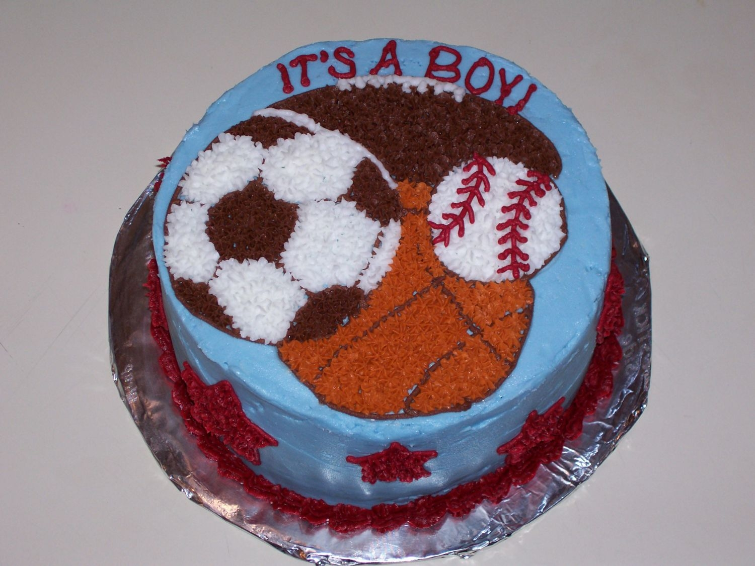 Sports Baby Shower   My first paid cake! All buttercream...I just hope it stops snowing so people come to the shower tomorrow!