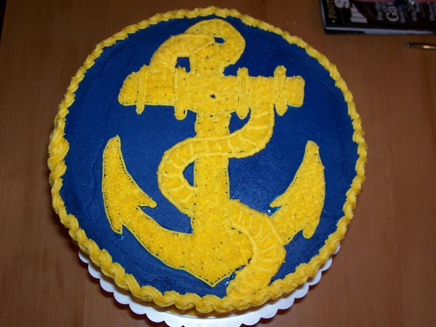 Go Navy!   Gold Navy anchor on Navy blue BC cake. Made for Army-Navy Football Game party. Used piping gel transfer technique from Course I