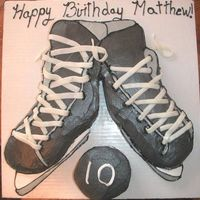 Hockey Skates And Puck I made this for an order tomorrow. It's a sculpted cake, iced with butter cream icing and the laces are made out of mmf.