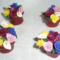 Mmf Flower Pots I made these miniature flower pots for a cake I have to do in a couple of weeks. They're about 2 inches tall. I'm just starting...