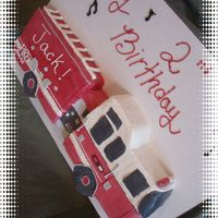Fire Truck A white cake with choc. mousse filling decorated with SMBC.