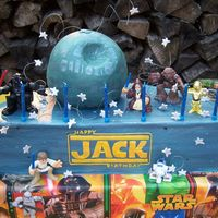 Jack's Star Wars Cake 18 inch half round pan, ball pan. buttercream with fondant stars. characters are action figures