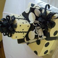Polka Dot Wedding Black and white polka dots on 6,10,14 inch layers. frosted in buttercream, added fondant dots. bought the black spray in the can from...