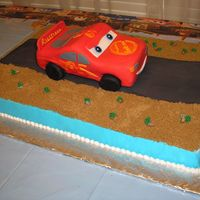 Cars Birthday Cake The car is sculpted from a 9 x 13 sheet cake which was cut in half and stacked, covered in fondant, and then elevated above the main sheet...