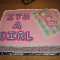 Baby Shower Cake Sheet cake with hand made fondant baby on fondant quilt