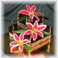 Kellie.jpg Two tiered mud cake for best friends 30th, star gazer lillies the highlight for meI have to learn to make smaller flowers