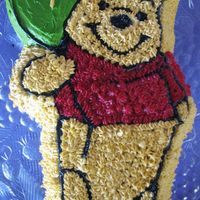 Pooh Bear  This is the first time i'd used a shaped pan and the piping of stars as a technique, the little girl was delighted. I was quite happy...