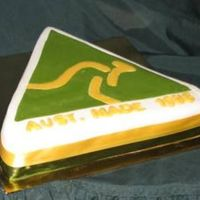 Australian Made Logo  i had a request for this one for a 21st birthday. I did this one purely using fondant, covered it in white and cut out the triangle...